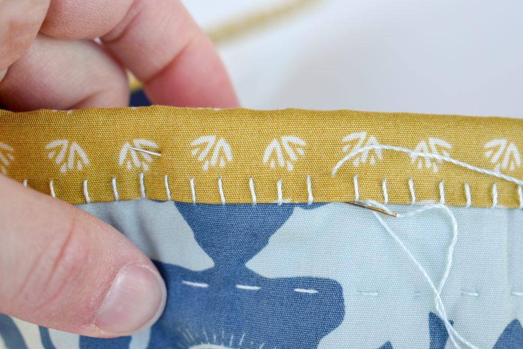 hand binding big stitches