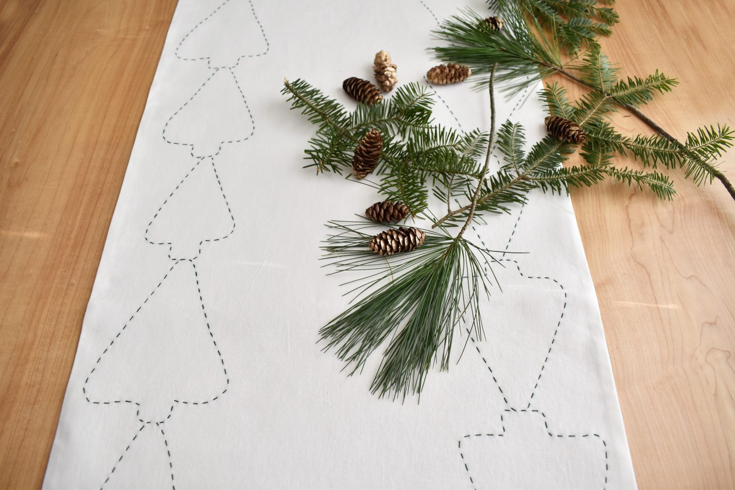 tree garland table runner brings festive decor to your table