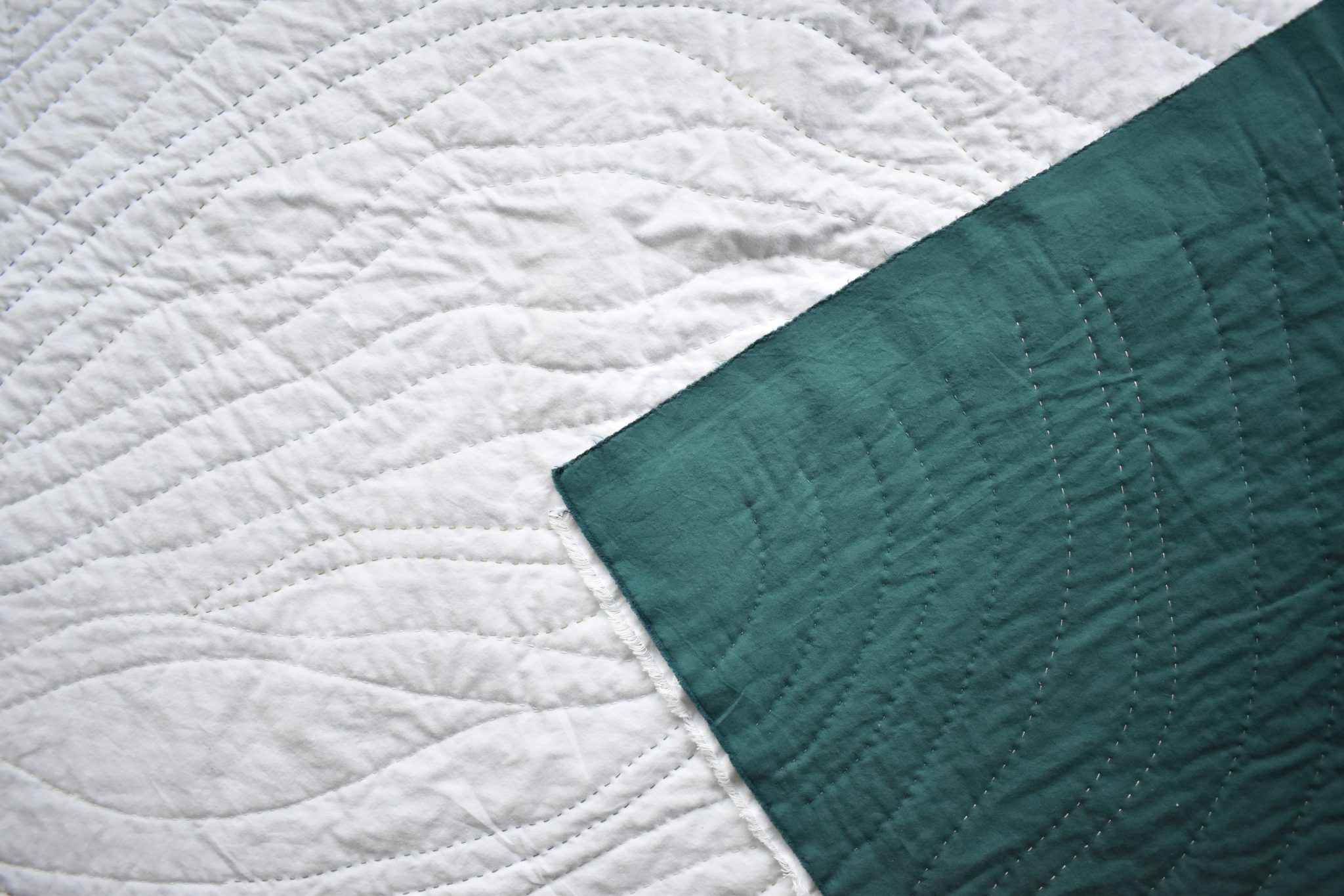 An organic hand-quilted wholecloth quilt