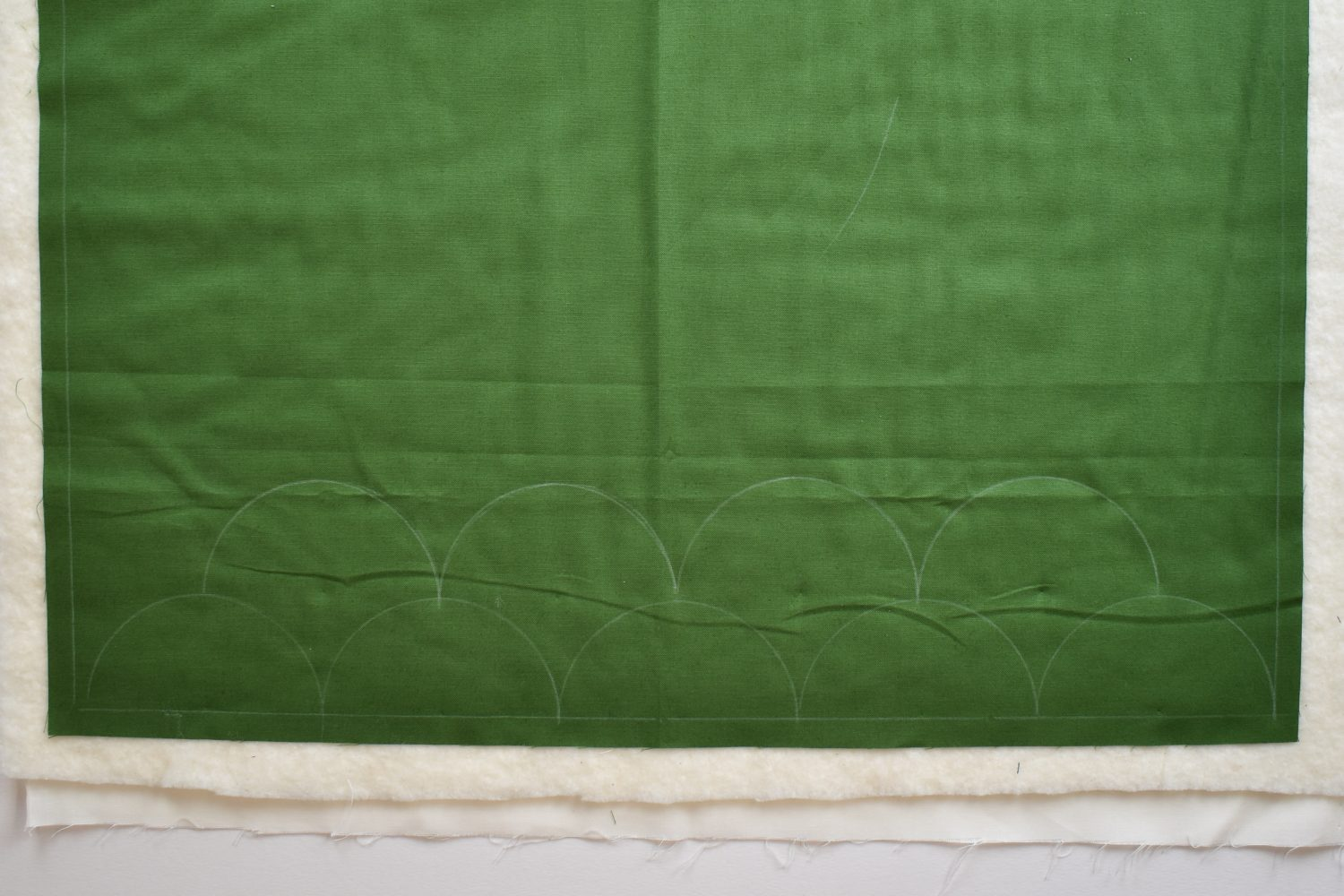 marked clamshell design for hand quilting
