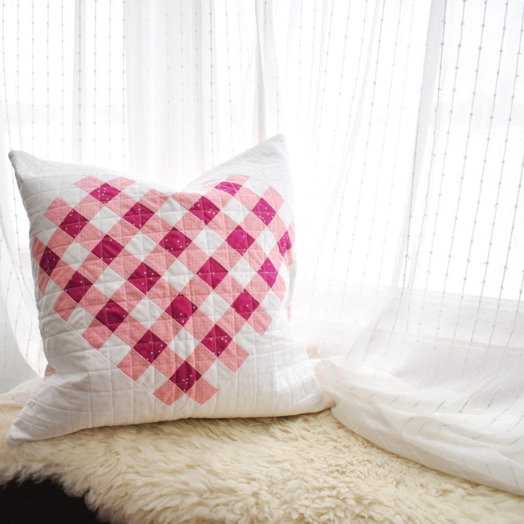 modern quilted heart pillow