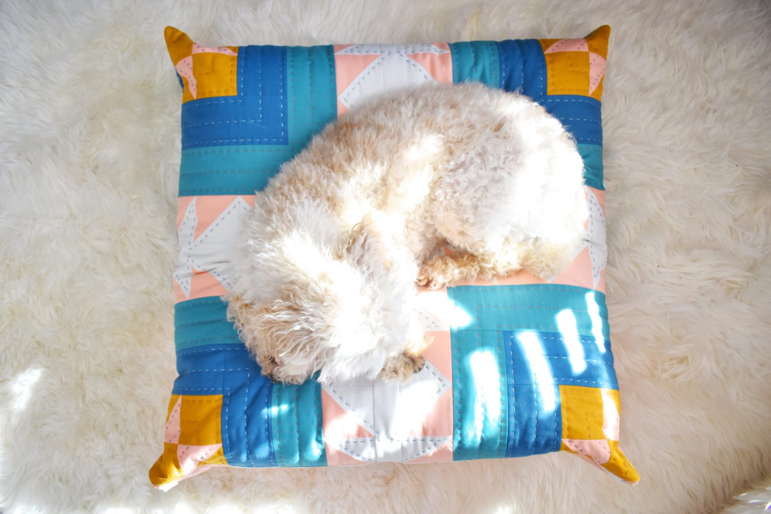 DIY a dog bed using a quilt