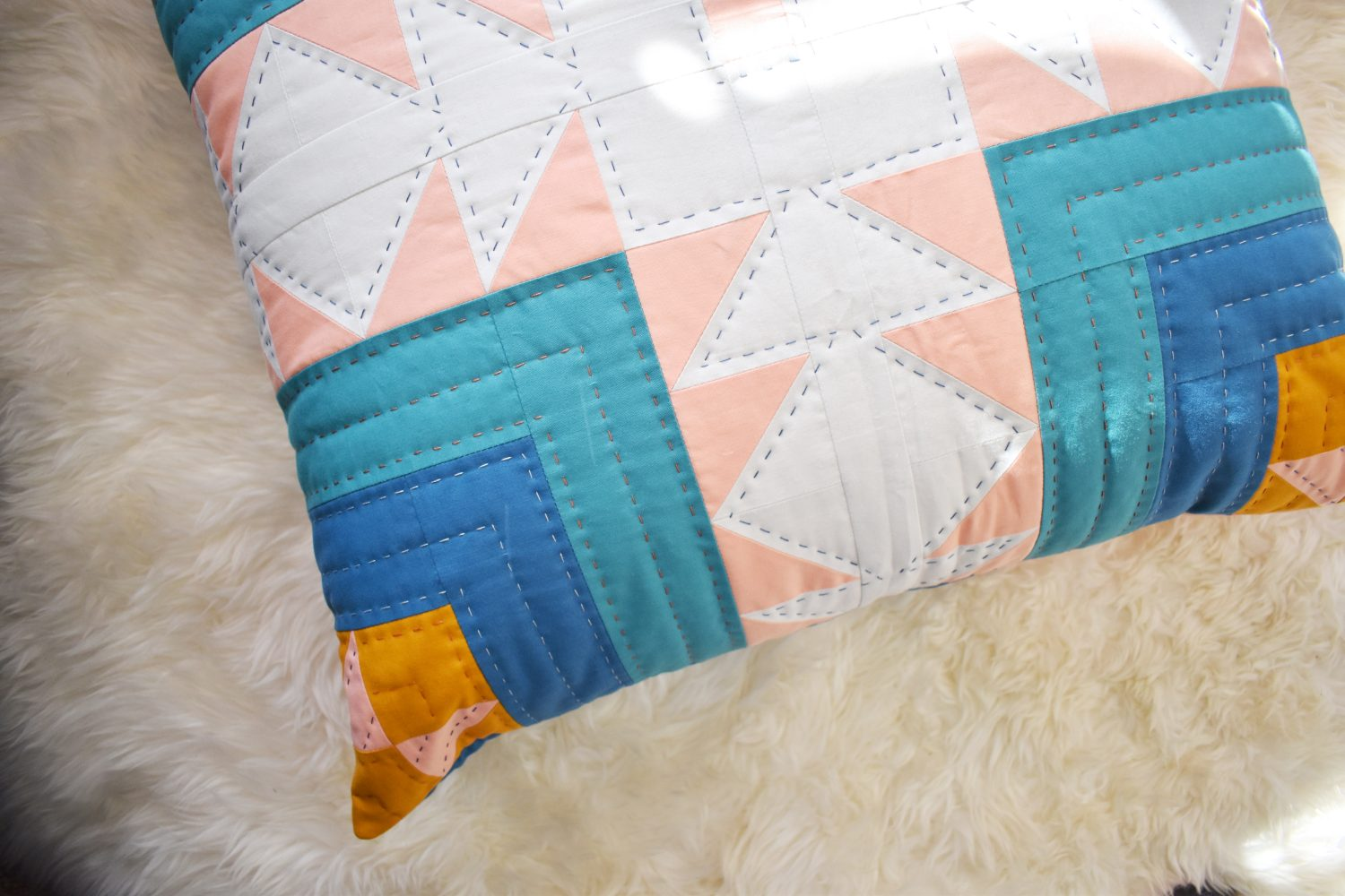 Hand quilting adds a lovely touch to this floor pillow