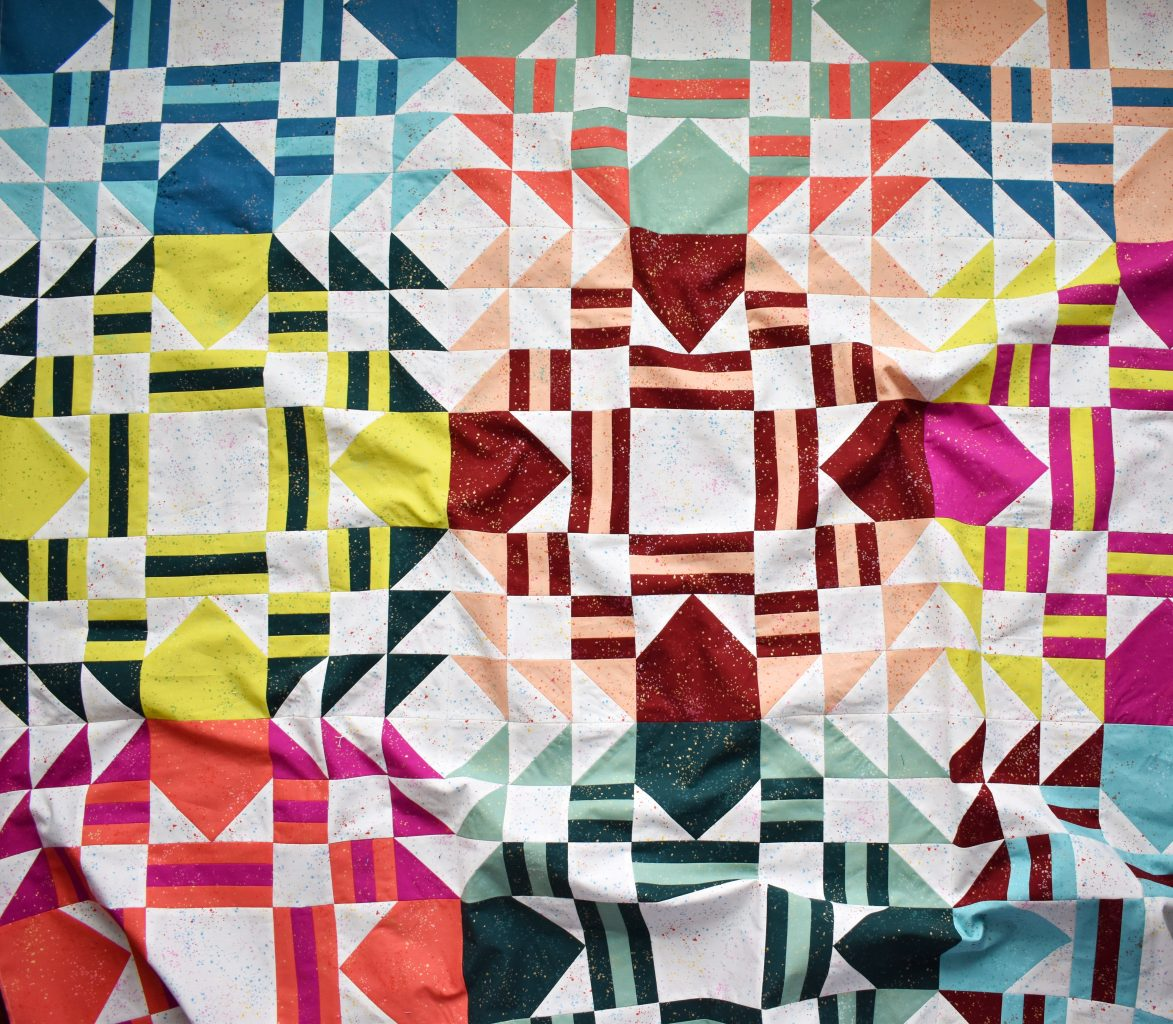 Everglow lap size quilt top in Ruby Star Society fabrics