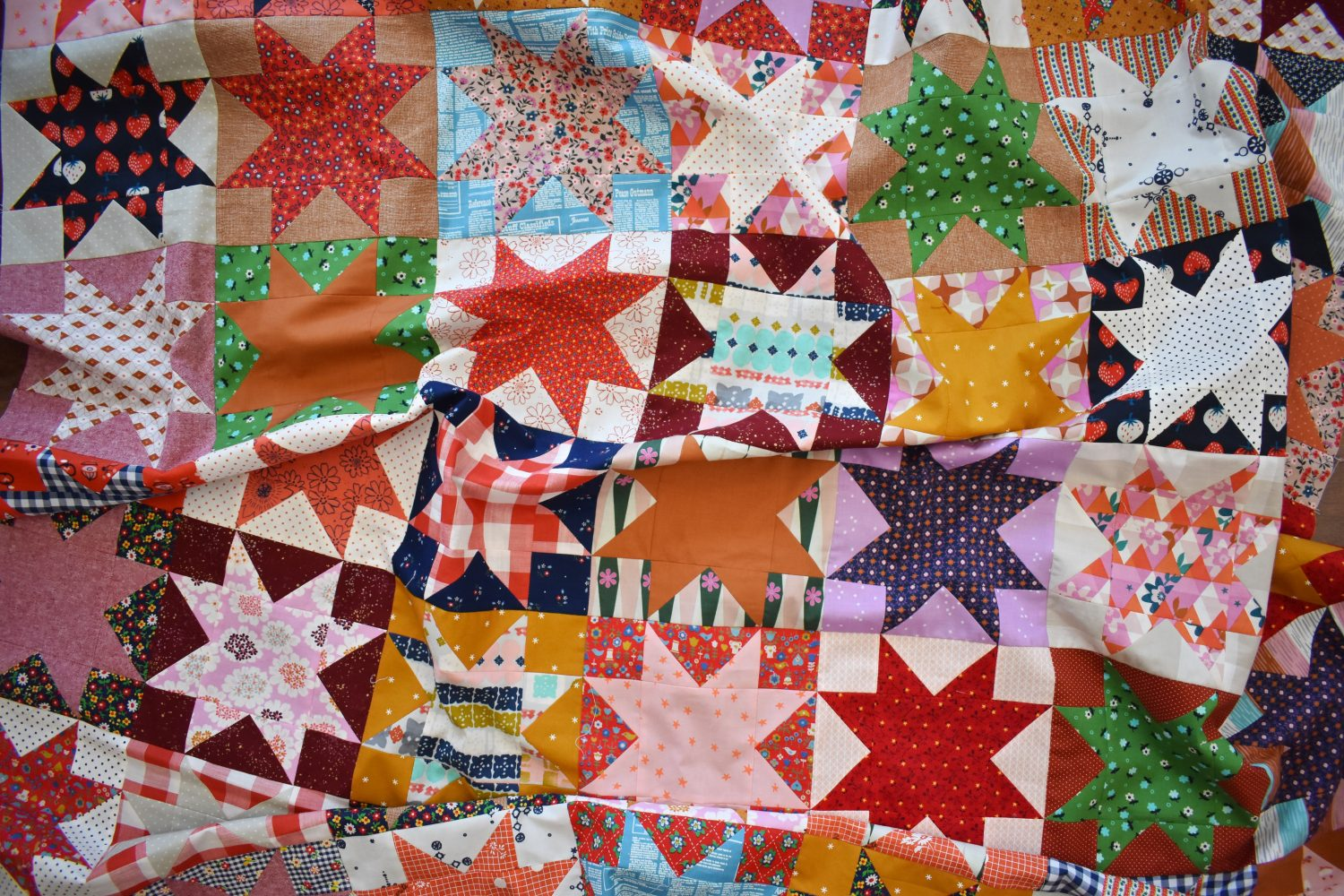 Using over 40 fabrics to create this scrappy star quilt top
