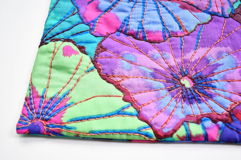 A mug rug made with a bold floral fabric