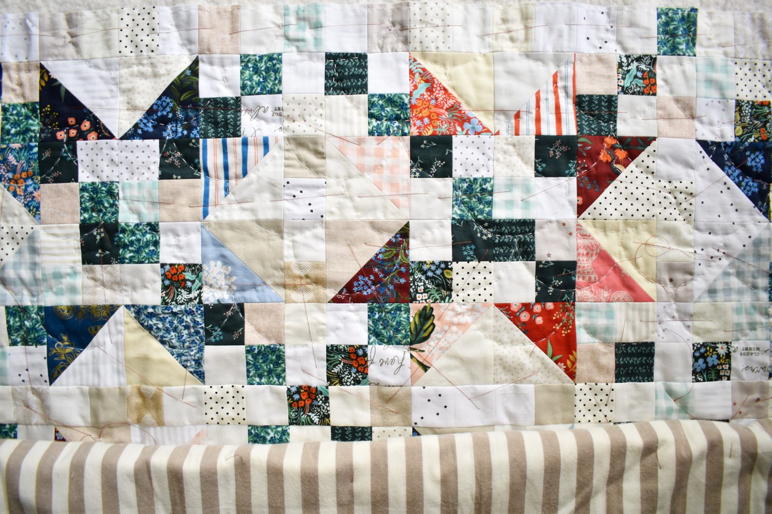 Starlite quilt with hand quilted clamshells
