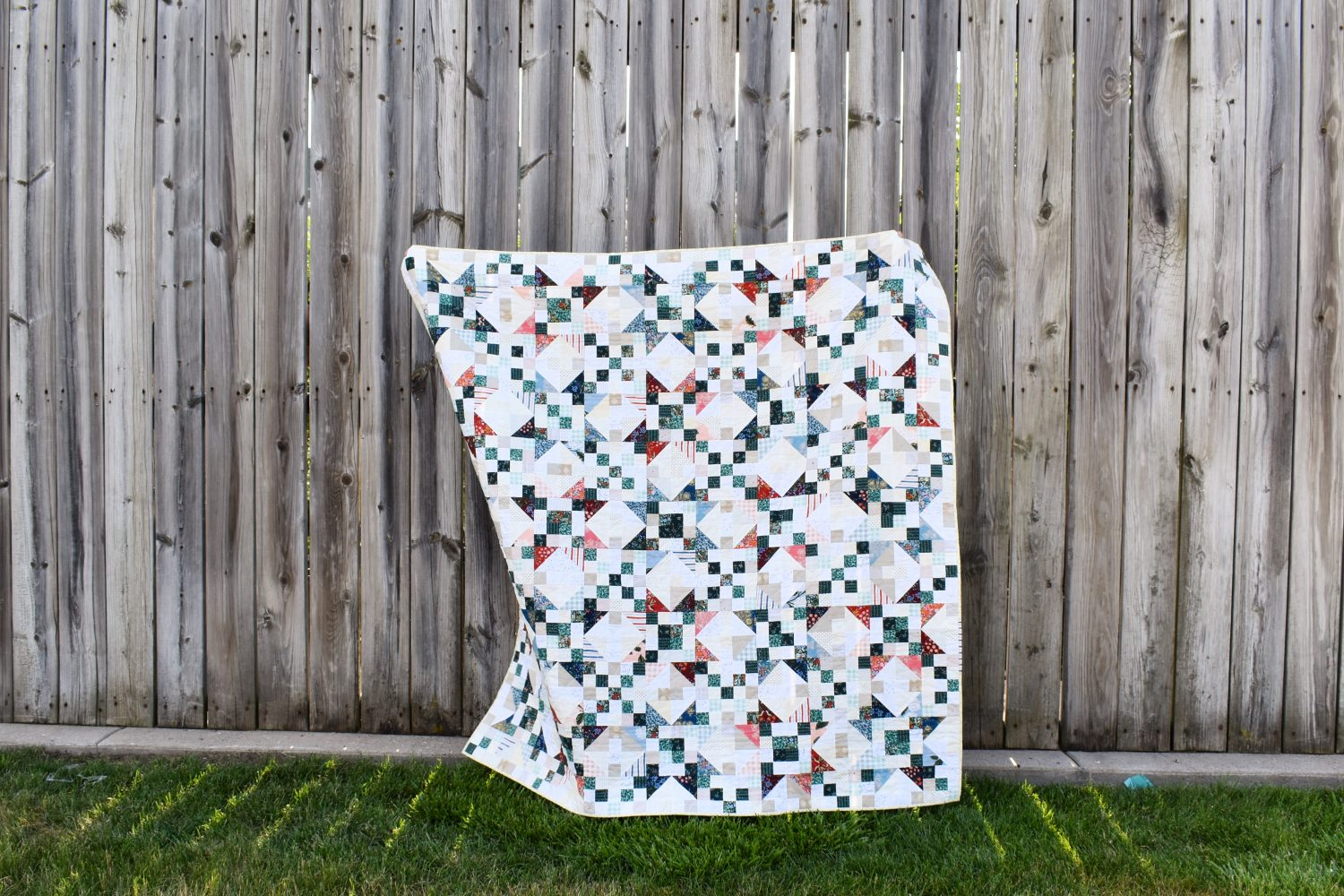 A finished Scrappy Starlite quilt