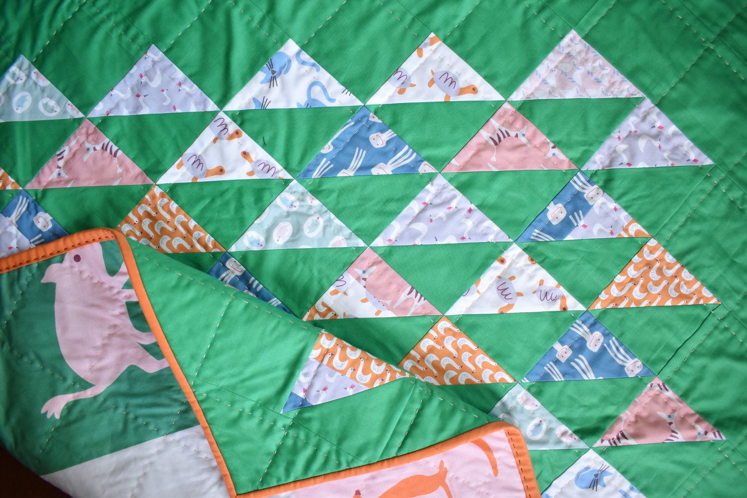 A baby sized Spyglass quilt with animal prints