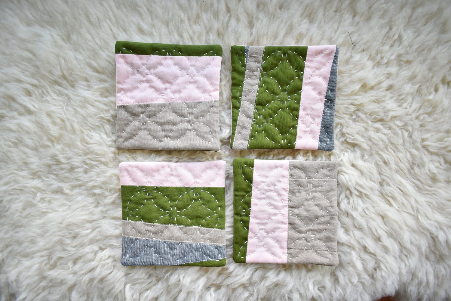 A set of 4 scrappy coasters with hand quilting
