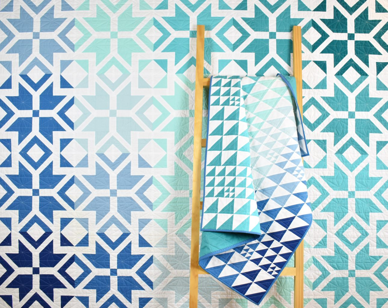 Nordic Star and Wonderie Ombre quilts in blue and teal